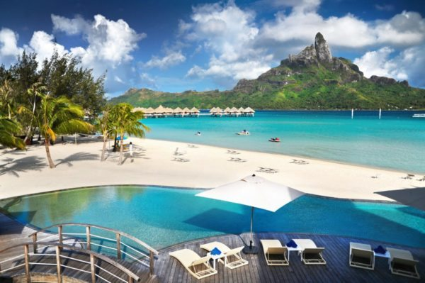 resort in Bora Bora with clear blue beautiful water and overwater bungalows