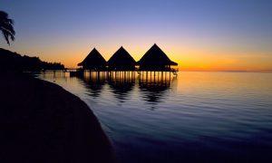 a romantic tahiti sunset for honeymooners