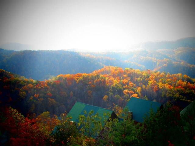 view from log cabin over the mountains during fall
