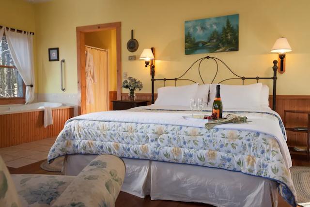 Inn & Spa at Cedar Falls Honeymoon Cottage master bedroom