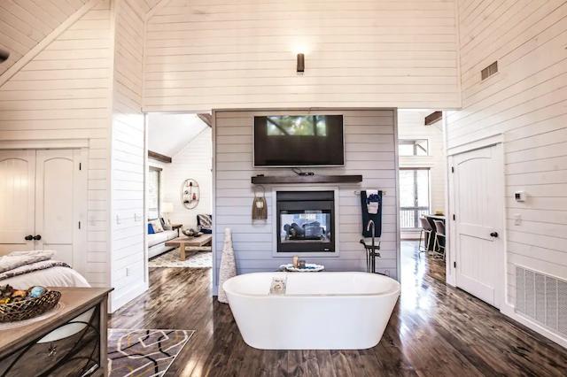 luxury cabin bath tub next to fireplace