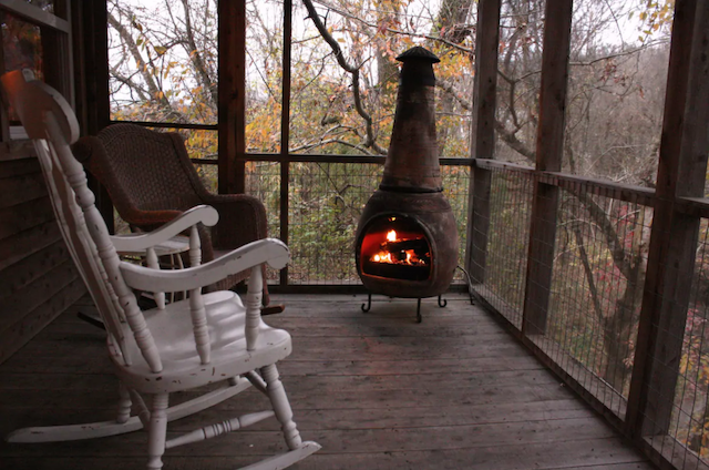 romantic porch with fireplace and rocking chairs