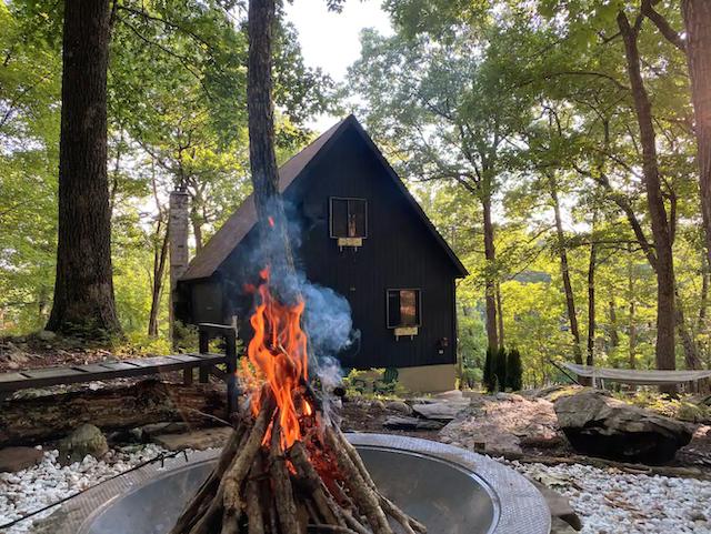 Fire pit outside of Black Cabin in the Woods in Bushkill, Pennsylvania