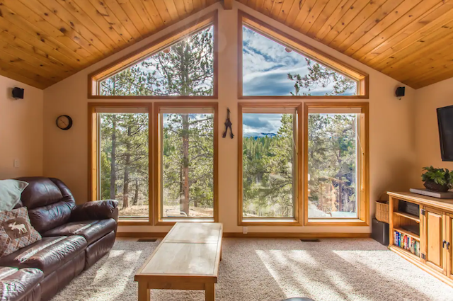 cabin living room with floor to ceiling window views