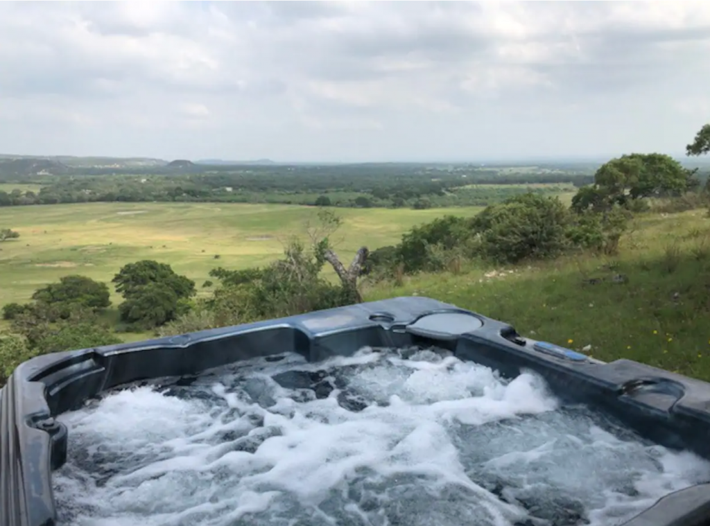 hot tub with a view from the cabin