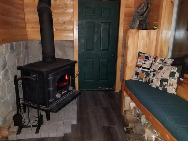 Hawk's Nest Kabin interior with wood burning stove