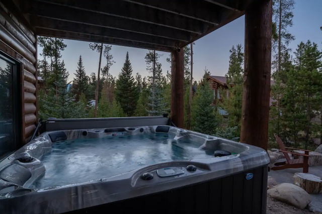 Hot tub with views and cabins in the distance