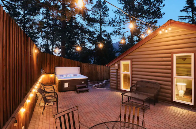 Cabin back yard area with hot tub and seating