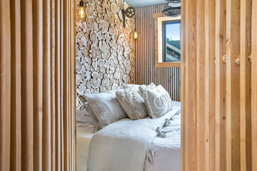 cabin bedroom with beautiful unique wood walls