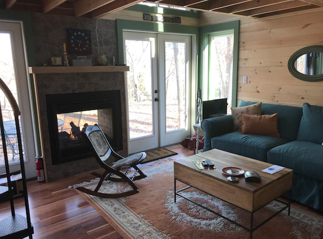 Sweet Escape Tiny House Cabin interior living room with fireplace